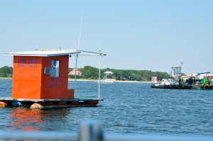 The bright orange floating boat shack in near St. Andrews State Park. During the summer of 2010 one of the BP cleanup work stations was just a short distance away from this well known marker.